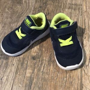 Navy and green Nike 5C tennis